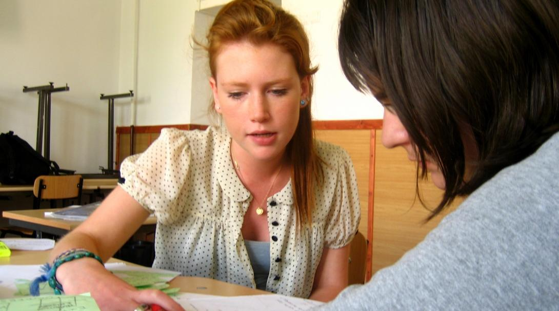 A teacher give extra English lessons to a student who is struggling during her teaching work experience in Romania